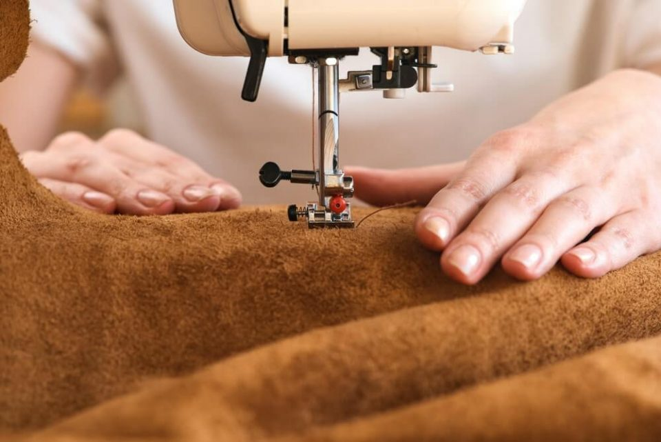Artisan sewing leather