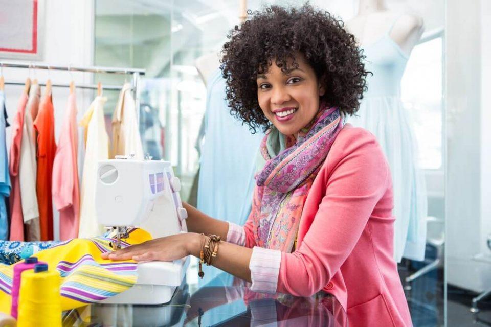 Female fashion designer using sewing machine
