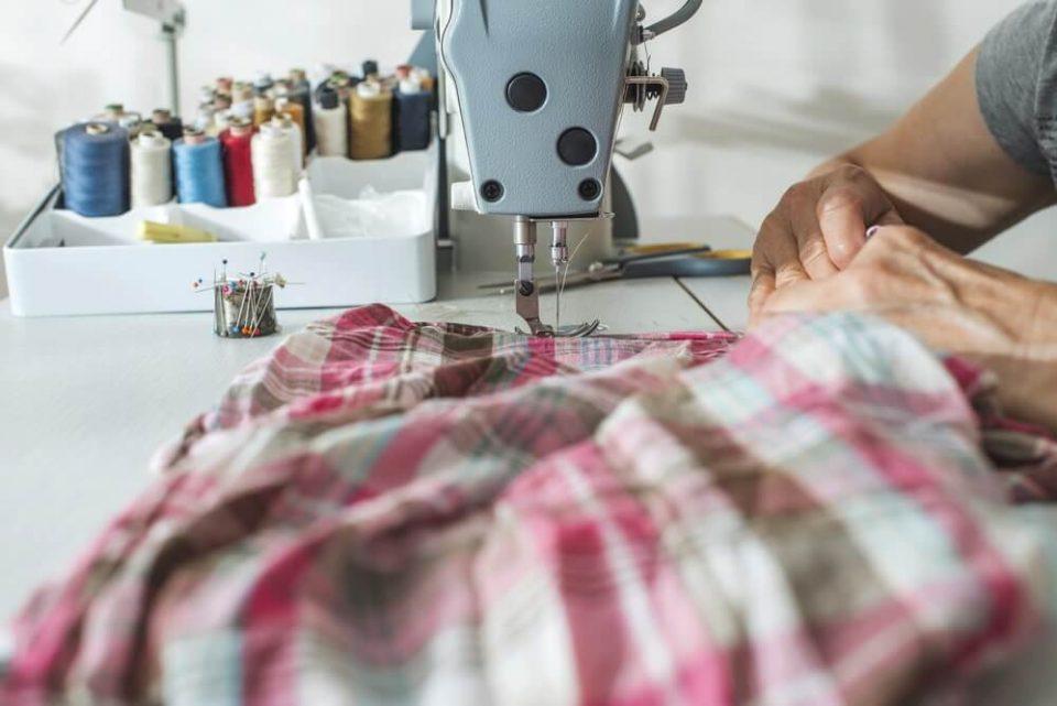 Man using sewing machine
