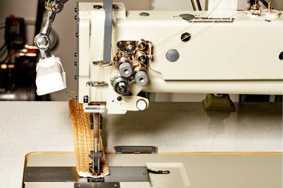 Modern machine for sewing furniture upholstery, the working part of the sewing machine close-up, copy space