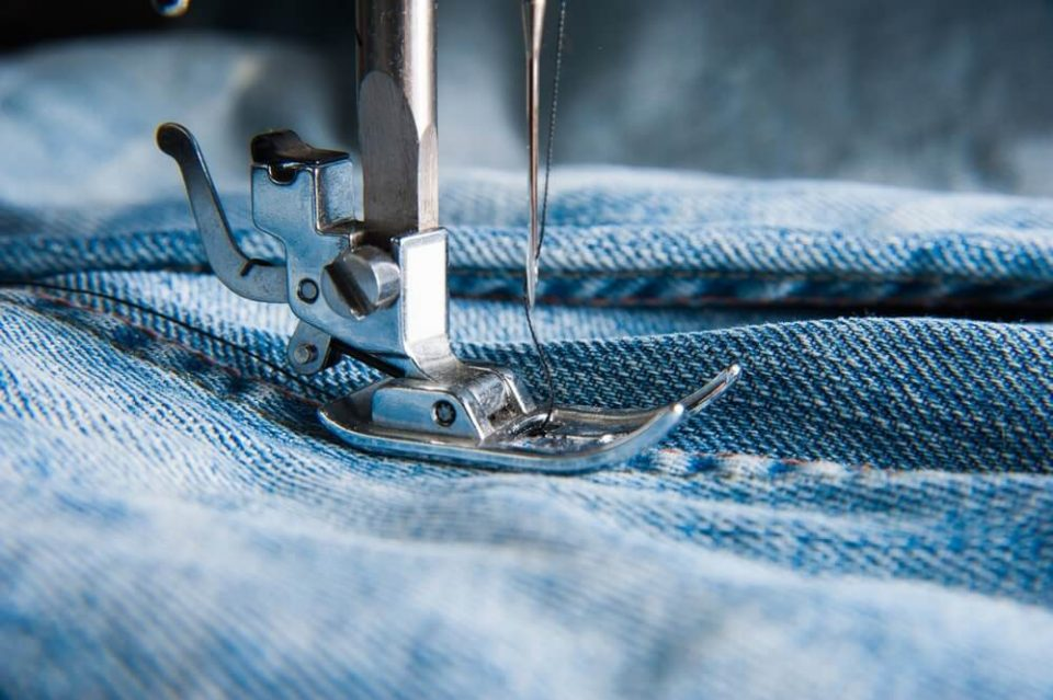 Part of sewing machine and jeans cloth