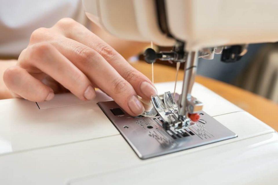 Seamstress threading sewing machine