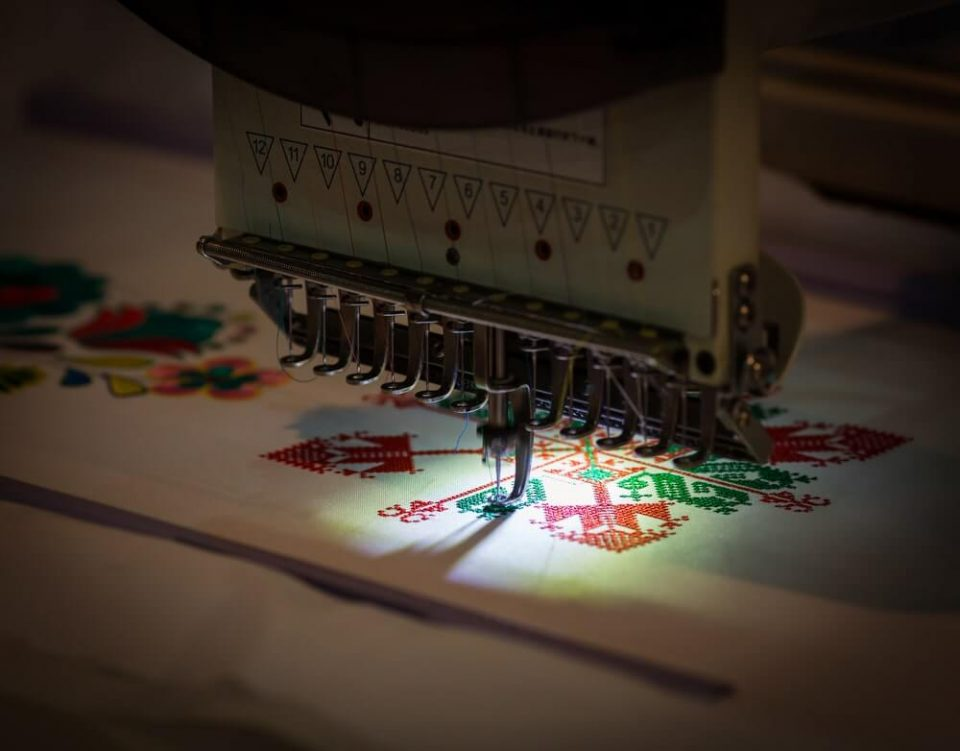 Sewing machine making embroidery pattern